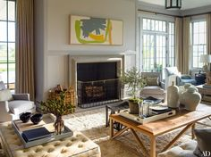 A canvas by Friedel Dzubas is mounted above the living room's limestone mantel.