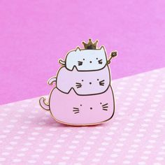 The tiniest little cat emperor! Because we all know that someday cats will rule the world .. or do they already?    Swear your allegiance to our feline overlords with this adorable pastel pin. Perfect for the cat lover or anyone whose heart is rule by these furry little dictators.  • 1″ x 1″ • made of the highest quality hard enamel • gold finish • my original design • rubber clutch