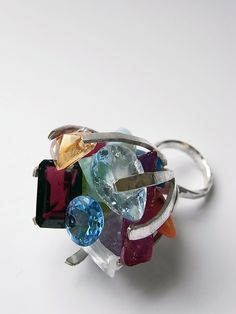 claw ring in silver with multiple stones by Kelvin J Birk