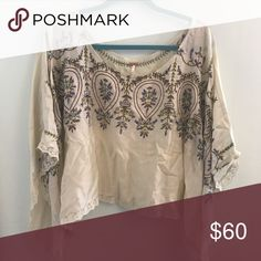 •Free People• Embroidered Poncho Top The most gorgeous top! Very loose and poncho like. Does have arm holes. Embroidered and has lace on the edges. Free People Tops