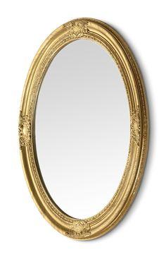 Spegel med dekorativ ram.