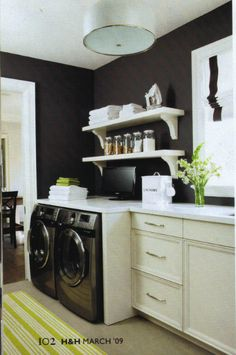 I love the setup for this laundry room. Everything is clean and organized.