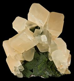 Calcite crystals in cluster atop Mottramite covered matrix. From the Tsumeb Mine, Tsumeb, Namibia, SW Africa. Measures 11.5 cm by 11 cm by 7.8 cm in total size.