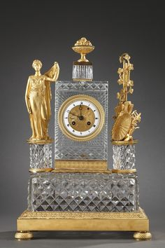 A fine figural mantel clock in cut-crystal and gilded bronze with allegorical decoration composed of a woman wearing a classic tunic and the symbols of the Agriculture placed on...