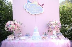 """This table, anchored by two flower arrangements and filled with tasty treats, is a must for any royal celebration. Christine said, """"Complete with magical princess macaroons, Sofia the First cake pops, and personalized chocolate bars and cupcakes, the dessert displays earned two thumbs up from the birthday princess and her guests."""" Source: Melody Melikian Photography"""