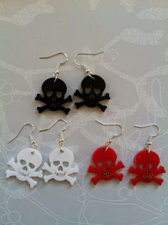 Skull and Cross Bones Laser Cut Earrings. £2.50, via Etsy.    geek,chic,fashion,jewelry,accessories,fickle queen, nerd, ring, bracelet, necklace, kawaii, kitsch, cute, awesome, romance, kawaii, home, wonderland, books, quirky, statement, candy, food,