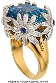 Aquamarine, Diamond, Sapphire, Platinum, Gold Ring, Jean Schlumberger for Tiffany & Co. The ring features an emerald-cut aquamarine measuring 15.60 x 11.90 x 8.90 mm and weighing approximately 13.00 carats, enhanced by full-cut diamonds weighing a total of approximately 1.00 carat, accented by round-cut sapphires, set in platinum and 18k gold, marked Schlumberger Studios, Tiffany & Co., reference no. 24194868. Gross weight 25.60 grams.