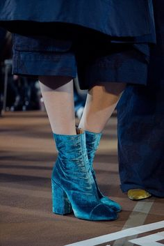 Blue boots at Dries Van Noten AW15 PFW. See more here: http://www.dazeddigital.com/fashion/article/23955/1/dries-van-noten-aw15