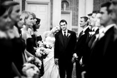 Looking down the line of groomsmen and bridesmaids to the bride and groom