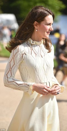 Kate's lacy cream dress, which nipped in at the waist and flared out, showed off her toned figure. She paired the outfit with a pair of pearl drop earrings and a pair of wedges