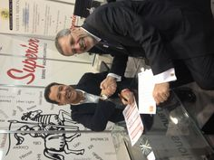 Lonny Schwartz, President of Superior Sewing Machine & Supply, signing his exhibit space contract with David Audrain, President of Clarion Events North America, for ExpoProduccion 2014 in Mexico City, to be held February 5-7, 2014.