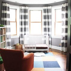 For bold, attention-stealing striped curtains like these, you'll need extra long IKEA curtains and heather gray fabric to glue on top. See more at IKEA Hackers »   - HouseBeautiful.com