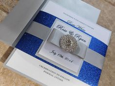 A Glamorous Royal Blue Bling Jewel Wedding Invitation with a lovely Monogram band!. Features a stunning crystal jewel and an sparkling silver band and a Gorgeous Bow! Can be made in any color. We are proud to announce that we were recently featured in Style me pretty Magazine: Check out the link! http://www.stylemepretty.com/california-weddings/dana-point/2014/03/31/romantic-pink-white-wedding-at-st-regis-monarch-beach/  Check out our 100% positive...