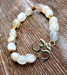 Moonstone, Hematite and Om Women's Bracelet $21.11 Soul Sisters Designs soulsistersdesigns.com  Moonstone nuggets with gold luster Hematite spacers all connected with the sacred OM symbol!!