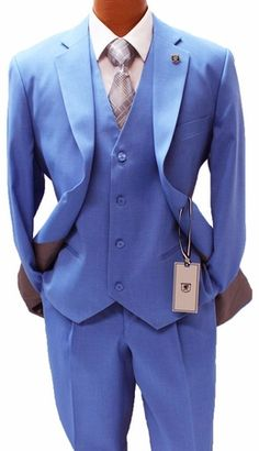 fbc38ca1b3c This bold blue color 3 piece suit features a regular classic fit with the  vest and pleated pants with the style and look that you expect from Stacy  Adams ...