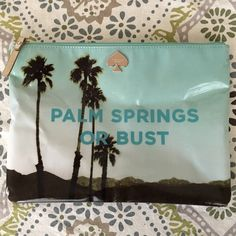 """Kate Spade Palm Springs or Bust Clutch This fabulous clutch in seaglass color features a charming desert print on front and back.  It is a flat pouch with zip closure.  This only been used once, so it is in like new, excellent condition.  Approx. 7.5"""" tall, 10.5"""" across.  Large matching tote is listed separately! kate spade Bags Clutches & Wristlets"""
