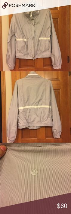 Lululemon jacket Lululemon jacket with thin grey vertical stripes and white trim. Rain jacket/wind breaker material. Size 8. In excellent condition - no signs of wear. lululemon athletica Jackets & Coats