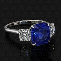 Leon Mege blue sapphire and antique cushion cut diamond ring. Gorgeous!