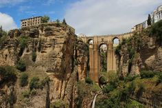 Ronda, Malaga Spain This century convent is now transformed into an educational art museum. The amazing bridge that spans between the rio Guadalven was built in the century and offers stunning views of the Serrania de Ronda mountains. photo by Zú Sánchez Ronda Malaga, Vila Medieval, Magic Places, San Pedro, Old Bridges, Three Bridges, Malaga Spain, Andalusia Spain, Beaux Villages