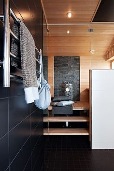 Sauna with stone, raised floor, window for natural light, glass wall. Basement Sauna, Sauna Room, Saunas, Sauna Design, Finnish Sauna, Spa Rooms, Grey Bathrooms, Bathroom Inspiration, Interior Architecture