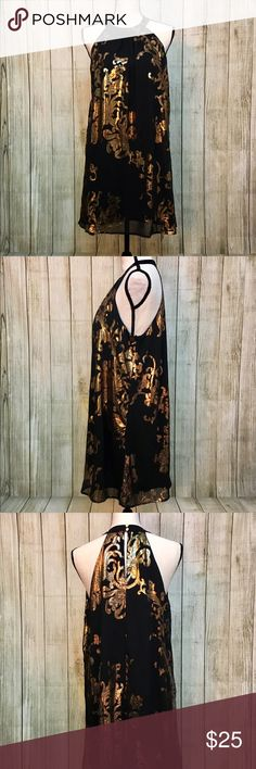 Gold and Black Halter Dress Scoop neck halter dress with metallic gold details showcase the beauty and elegance of this piece. Length from the neckline straight down: 32in. Bust: 42in. 100% Polyester. Gently worn once for 1 hr tops.  Dresses Mini