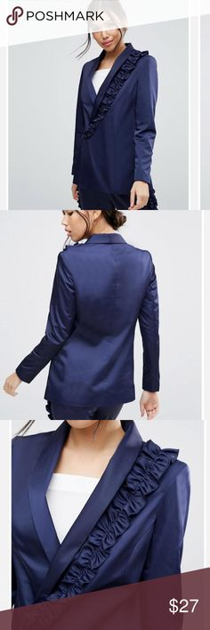 Asos women's Navy Ruffled Satin Jacket Blazer is crafted from lustrous midnight blue satin defined by an arymetric ruffle trim. Has a slender fit and shawl lapel. Has a 1 button that buttons from the underside to be hidden . Has the ruffle down one side of blazer. No pockets . It is lined . 96% polyester, 4% elastane. Lining is 100% Polyester. Lightly padded on shoulders.  Underarm to underarm is 19 that is measured on back . Length is 26 inches. ASOS Jackets & Coats Blazers