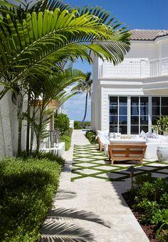 Florida Beach House with Coastal Farmhouse Interiors-Side patio