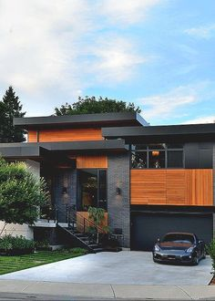 Stunning Modern Mansions - DuJour : See contemporary architecture inspiration, including a garage underneath a pool. See contemporary architecture inspiration, including a garage underneath a pool. Modern Exterior, Exterior Design, Interior And Exterior, Cosy Interior, Stone Exterior, Exterior Colors, Modern Garage, Roof Design, Luxury Interior
