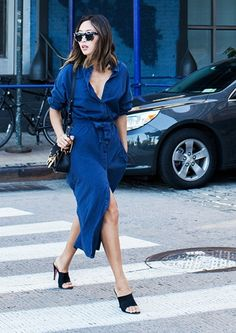Aimee Song wearing a shirtdress and mules.