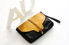 50% off black leather clutch with deep yellow leather braid