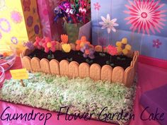 Gumdrop Flower Garden Cake I am so making this for mothers day! And I am going to add ladybugs to it too. Made of strawberries...I will post for sure for yall! so excited to make it cant wait :)