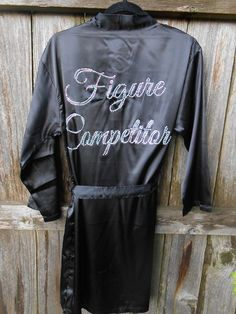 "Crystallized ""Figure Competitor"" robe made with black satin fabric with a fitted matching black tie. ""Figure Competitor"" in elegant cursive crystallized with crystal ab on the back of the robe. Bikini Competition Suits, Fitness Competition, Figure Competition, Physique Competition, Competition Time, Fitness Show, Men's Fitness, Muscle Fitness, Gain Muscle"