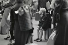 Young boy waiting to travel, possibly Waterloo Station, c.1960. | You're Strongly Advised To Look At These Awesome Vintage Pictures Of London
