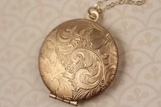 Floral Locket Necklace, 14kt Long Gold Necklace Chain, Gold Locket, Round Pendant, Paisley Flower Locket, Vintage Gold Locket, Leaf Jewelery by FreshyFig on Etsy https://www.etsy.com/listing/170193197/floral-locket-necklace-14kt-long-gold