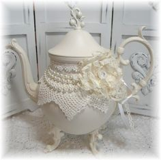 Vintage teapot that's been painted and decorated.  Beautiful....