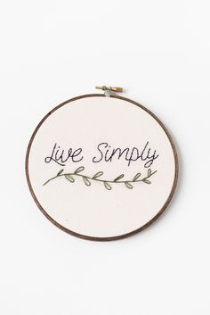 Live Simply // Hand Stitched Embroidery Hoop Art by Thistle & Thread Design in Louisville, Kentucky. A simple life is a serene life. Embrace your version of minimalism with this hand stitched embroide