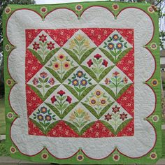 pinning for background fabric ideas...gorgeous quilt but I like the red/white to break up the white a little