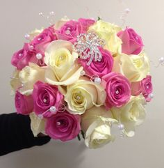 Fresh ball of roses using akito roses and aqua roses with diamante accessories. www.am-flowers.co.uk