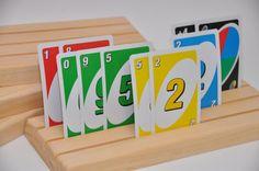 SET of 2 Wood Playing Card HOLDERS - Great for Kids Children Elderly with Arthritis - Uno Poker Gin Rummy Rook Bridge Canasta Spades +More! =  I have some that are made from 2X2's and they just don't have enough room to see your cards,  I think having a wider board  would be nice.  I also think making them out of 2X4's would be better than this,  but I like the idea