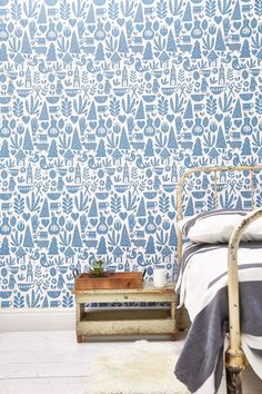 The bright blue design offers a break from the surrounding white rooms and smartly disguises asymmetrical ductwork. To balance the bold pattern, Jennaea kept the art simple; a pair of vintage paint-by-number horses reins in the look.