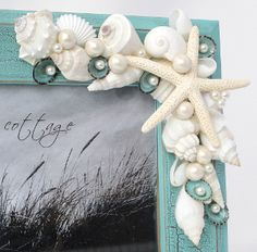 Idea for DIY seashell frame. Love the shells and pearls!