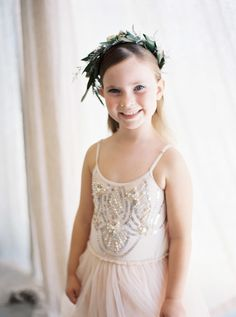 Adorable beaded blush flower girl frock: http://www.stylemepretty.com/2016/05/11/bohemian-wedding-on-waiheke-island/ | Photography: Katie Grant Photography - http://www.katiegrantphoto.com/