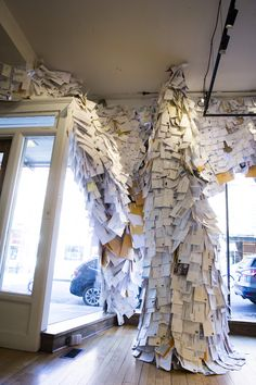 """Everyone Says Hi, envelopes, fabric, and window installation, Andrew Thompson—in """"Wish List"""" exhibition at the 117 Gallery at the Ann Arbor Art Center"""