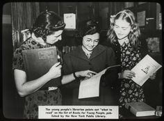 The young people's librarian and students, New York's Aguilar Branch, 1938.