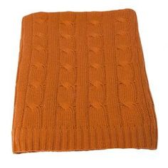"""Made from the most sought after cashmere from Inner Mongolia, this luxurious throw will have you hooked with a single touch. This blanket is perfect to drape over a couch, bed, or your favorite chaise.    Product: Throw Construction Material: Cashmere and wool blend Color: Paprika Features:  Perfect blend of cashmere and wool  Classic waterweave throw 2"""" Rib edges Dimensions: 50""""x 65"""""""