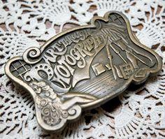 """art through photography"" vintage belt buckle"