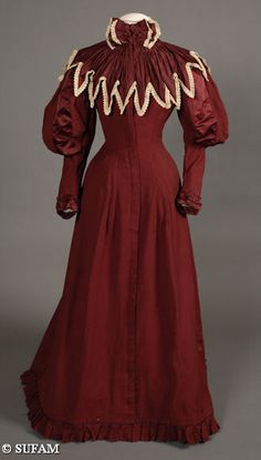 Woman's burgundy wool wrapper, 1894-1895. Standing collar is trimmed with a large bow of silk-satin and lace at the center front neckline. Worn by Sarah Eyre (Blair) Glover (b. 1861-d. 1929) of Richmond, VA. (S2010-01-137 Glover)