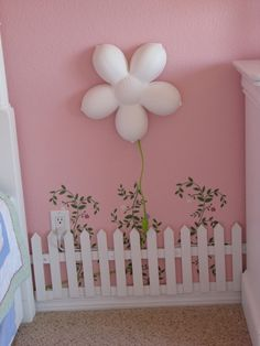 She already has that same light in pink. Totally want to do the little white picket fence with flowers and pink wall for her future garden themed room.