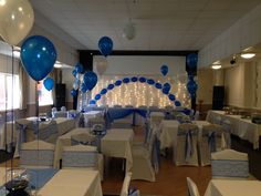 Blue and white balloons and wedding decorations, lace sashes over blue organza at Tor Leisure Centre Glastonbury