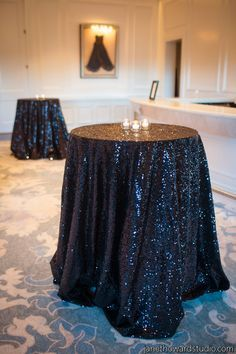 Black glitter table cloths on poseur tables